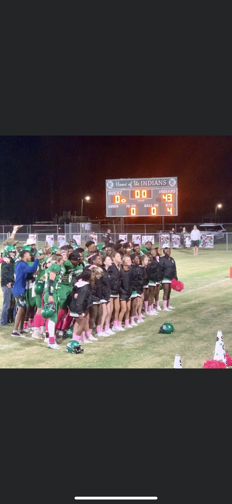 Indians football players and cheerleaders celebrating their victory.