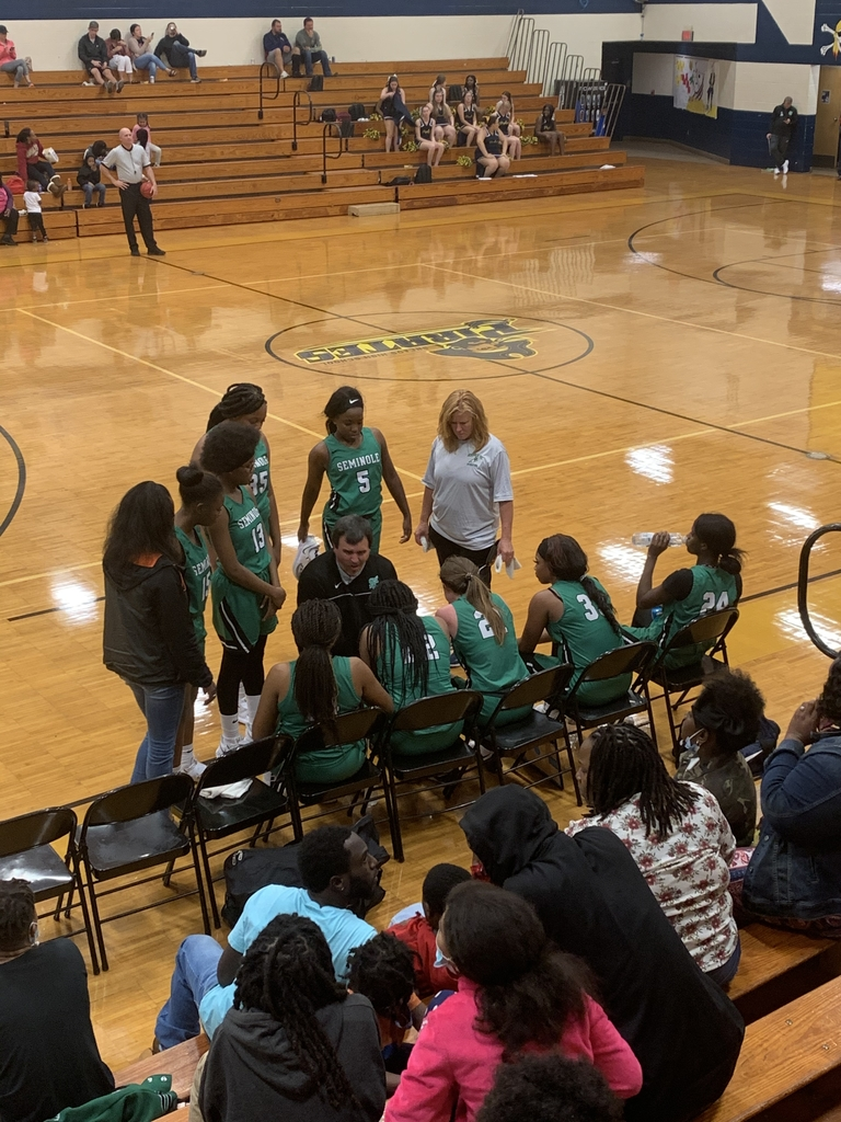Lady Indians get some instruction during the timeout.